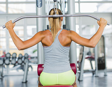 woman working out on a workout machine