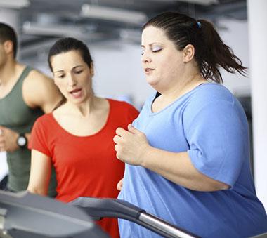 woman on treadmills