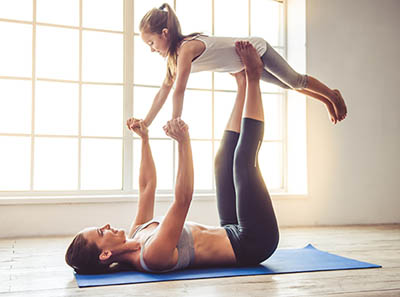woman exercising with daughter