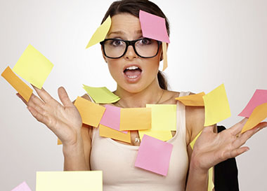 stressed out woman covered in post-its