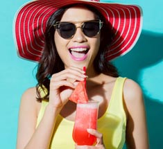 Happy Woman drinking watermelon drink