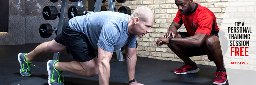 Man working out with a Personal Trainer at XSport Fitness